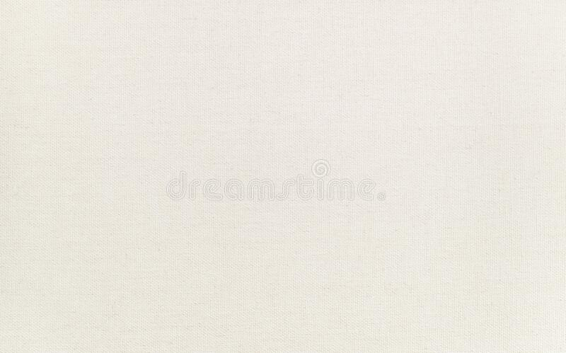 High quality artist canvas texture, macro shot with clear details. Clean surface. Natural ivory - cream colored, blank painting ca. Nvas stock photography