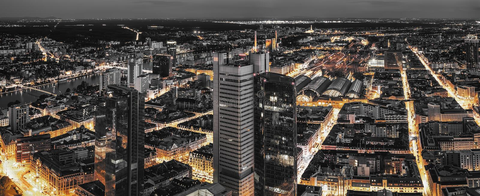 High quality black and white aerial panoramic view of Frankfurt, Germany at dusk. Yellow street traffic lights between stock photo