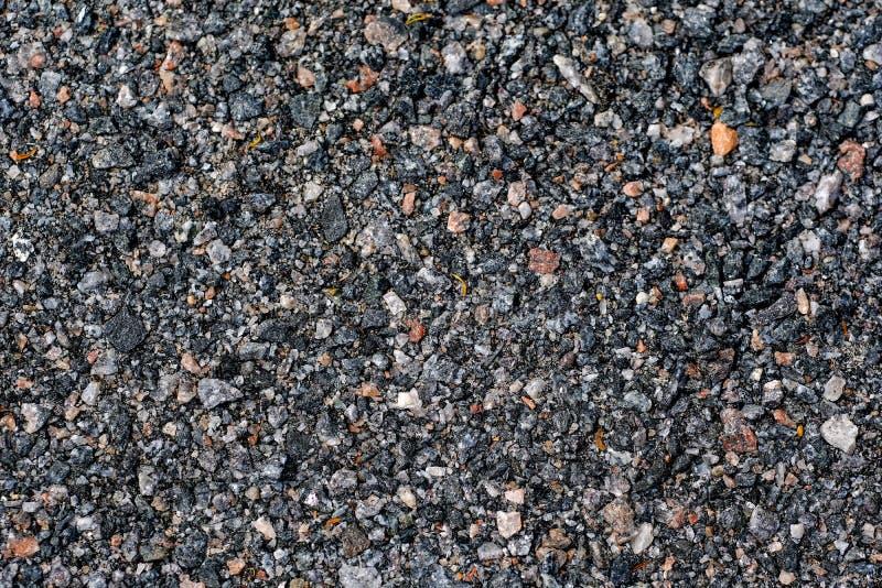 Asphalt grain, dark wet gray stones royalty free stock image