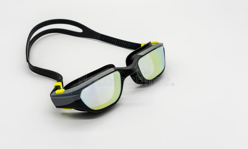 High quality fashion mercury coated swimming goggle in black, grey and green  on white royalty free stock photos