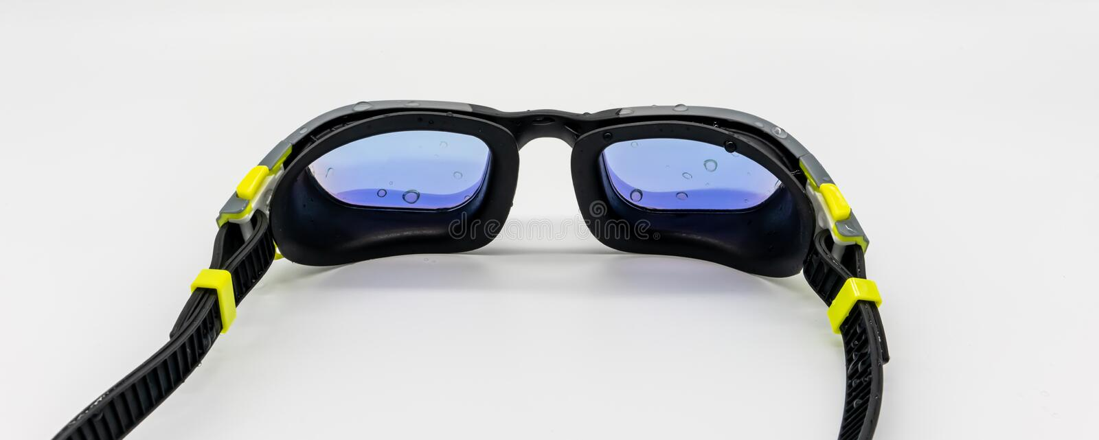 High quality fashion mercury coated swimming goggle in black, grey and green  on white stock photos