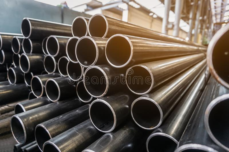 High quality Galvanized steel pipe or Aluminum and chrome stainless pipes in stack waiting for shipment in warehouse stock photography