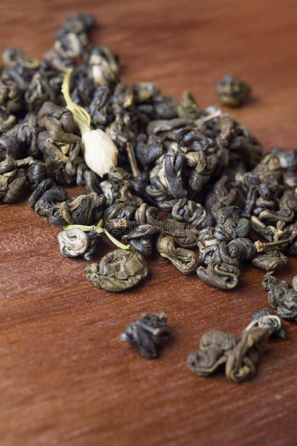 High quality jasmine green tea at wooden desk. macro shot royalty free stock image