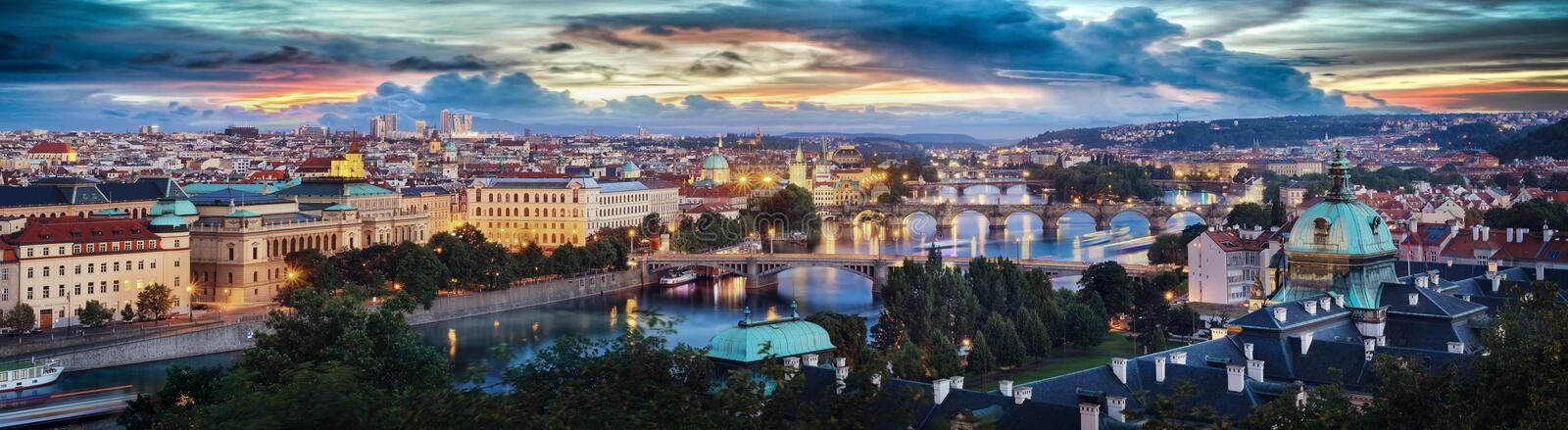 High quality sunset panoramic view of the Charles bridge on Vltava river and Old town in Prague, Czech republic. royalty free stock photo