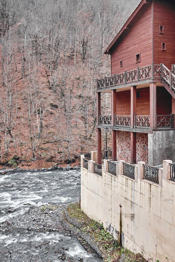 The structure at the mountain river in late autumn royalty free stock photo