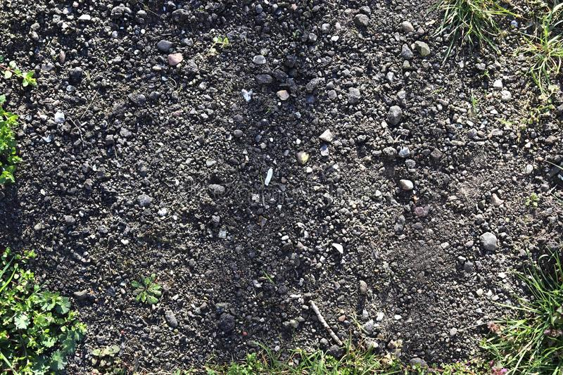 High resolution close up surface texture of gravel on the ground with high detail. Found in germany royalty free stock images