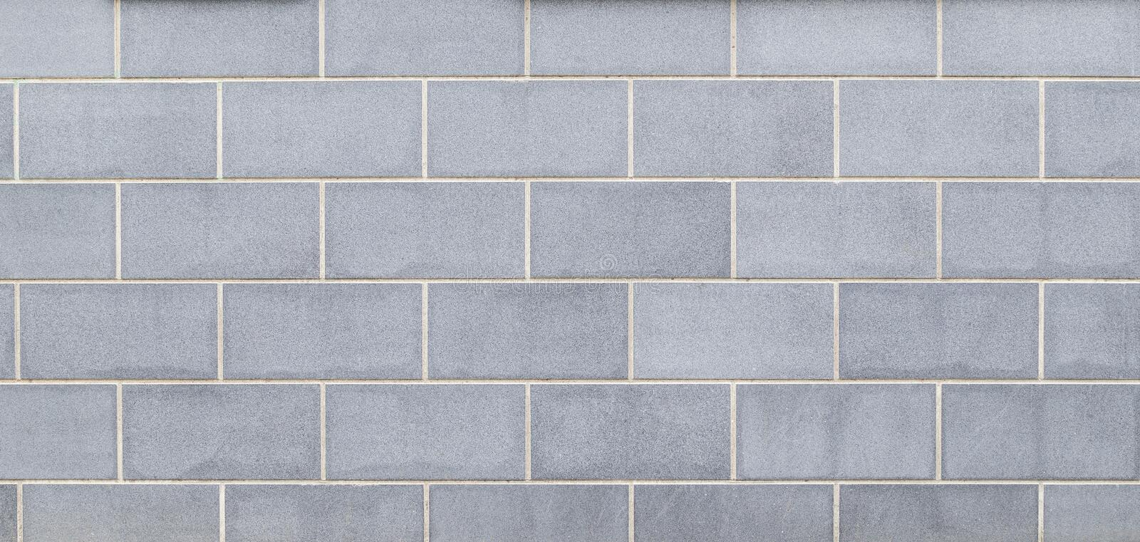 Modern light bluish gray slab wall background. High resolution full frame background of a new, modern and clean wall or building exterior made of light bluish royalty free stock photo