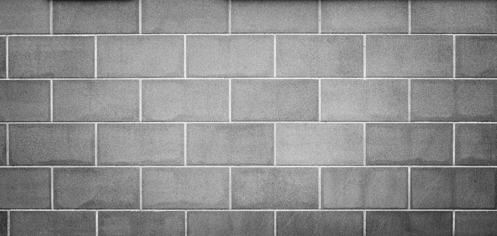 Modern gray slab wall background. High resolution full frame background of a new, modern and clean wall or building exterior made of stone slabs in black and royalty free stock photos