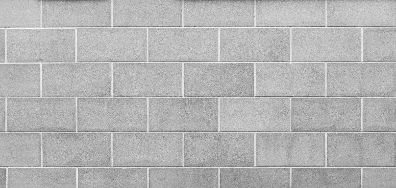 Modern light gray slab wall background. High resolution full frame background of a new, modern and clean wall or building exterior made of stone slabs in black royalty free stock photography