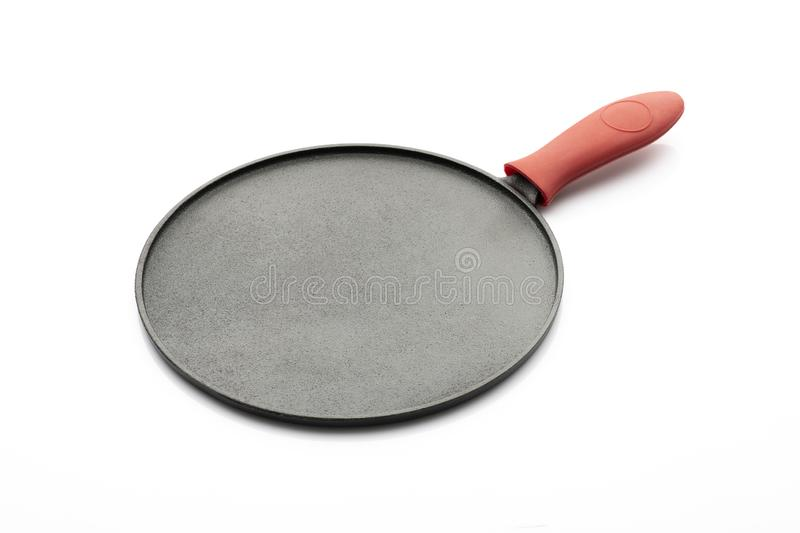 Seasoned Cast Iron Pan on White Background with Red Silicon Handle Grip stock photography