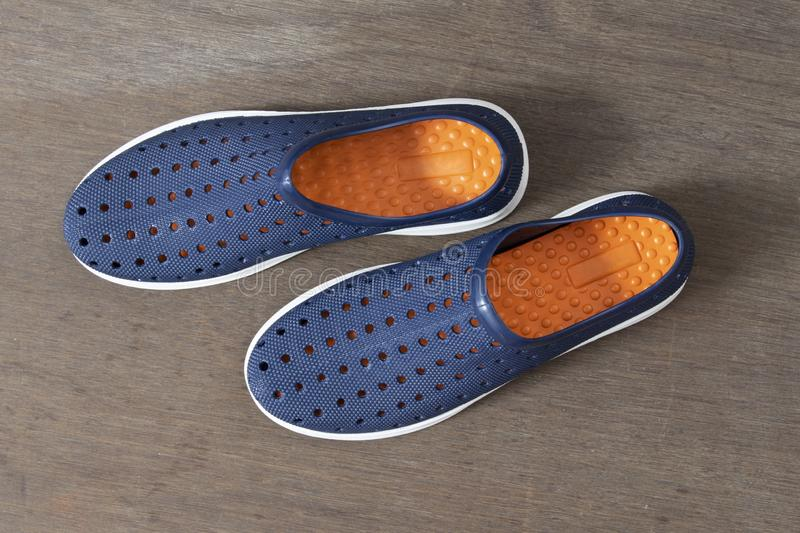 Top View of Pair of Blue Shoes Isolated on Wooden Background stock images