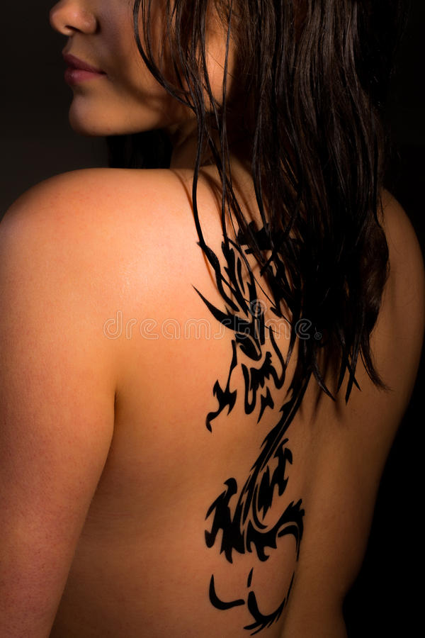 Young Women With A Dragon Tattoo On Her Back Stock Image