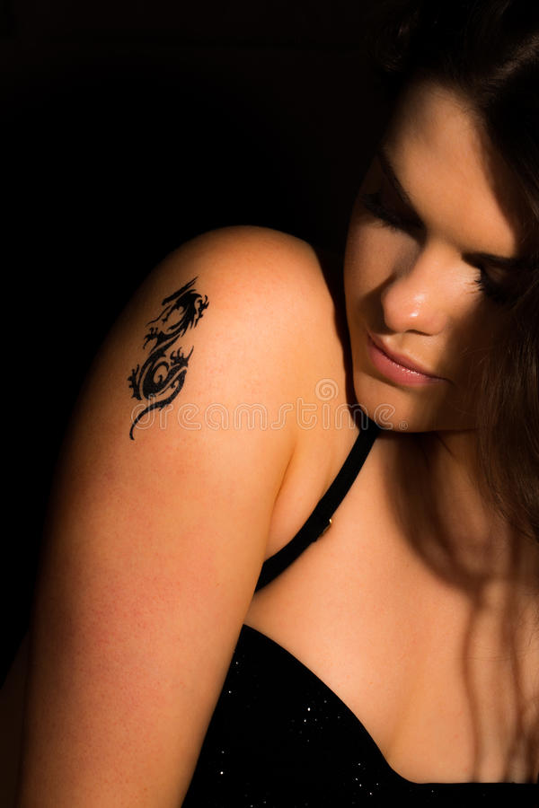 Download Young Women With A Tattoo On Her Shoulder Stock Image - Image: 30120767