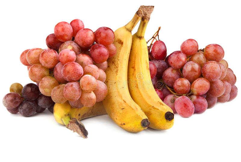 High resolution photo of red grapes and bananas stock photos