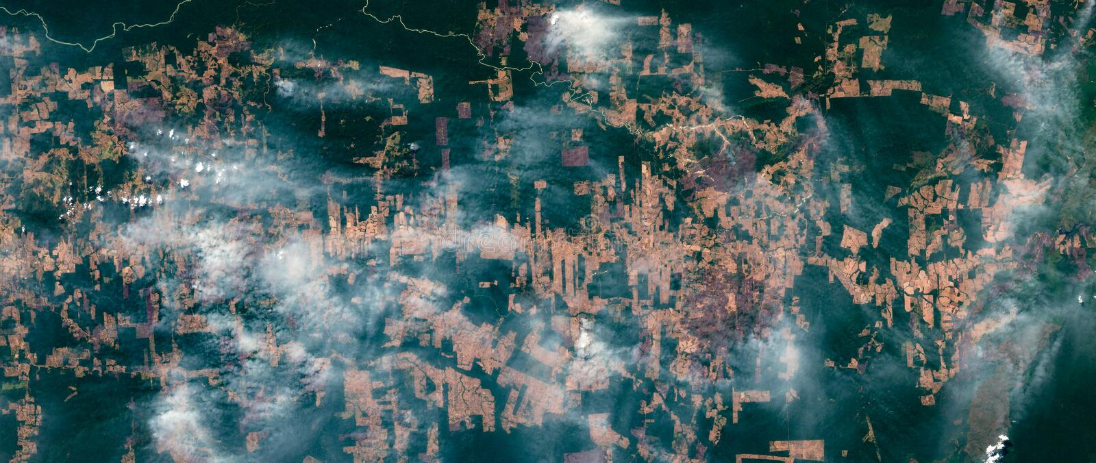 High resolution satellite image of forest slash-and-burn fires and smoke clouds in the Amazon rain forest in August 2019, Brazil stock image