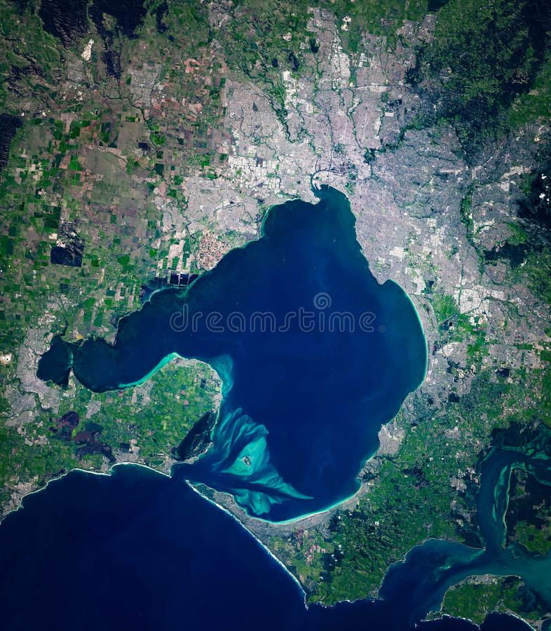 High resolution satellite image of Melbourne and Port Phillip bay, Victoria, Australia, from above, aerial view. Natural background map, contains modified royalty free stock photos