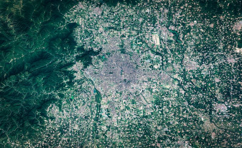 High resolution satellite image of Peking metropolitan area, China, background map, aerial view. Contains modified Copernicus Sentinel data [2018 royalty free stock photo