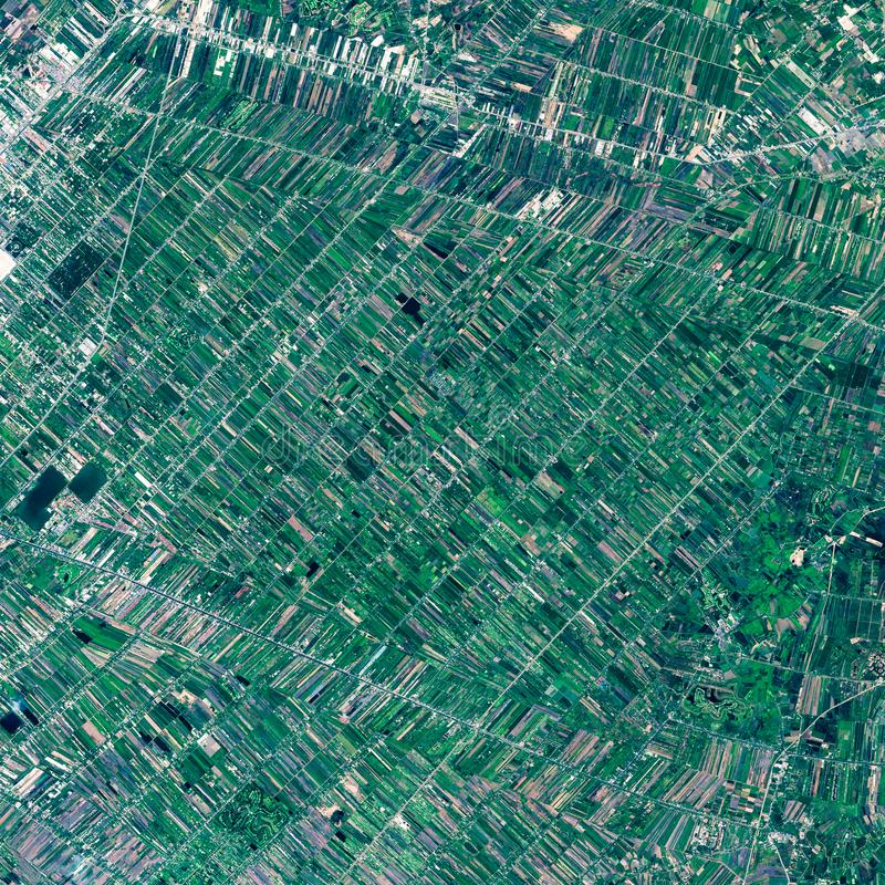High resolution satellite image of rice fields around Bangkok, Thailand, aerial view, natural background texture stock photography