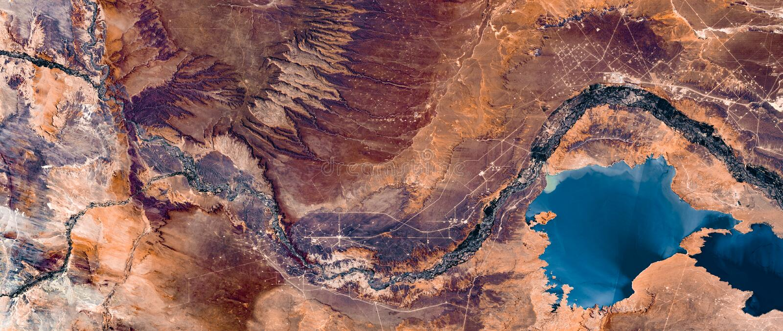 High resolution satellite image of river and Andes mountains from above, Neuquen, Argentina, natural background texture, aerial royalty free stock photo