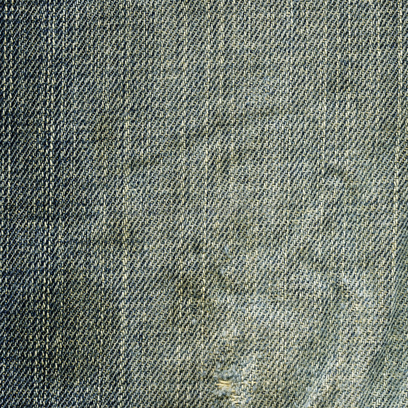 Denim Fabric Texture - Worn Out. High resolution scan of what used to be blue denim fabric with a worn-out look royalty free stock photos
