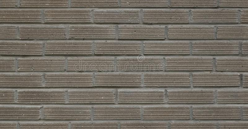 Full frame image of gray decorative brick wall, building exterior. High resolution seamless texture stock photo