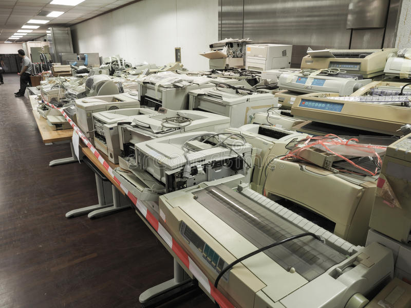 High resolution wide shot of pile or stack of old printers that. Are out of date. Outdated old printers are waiting for an auction or sell away as office trash royalty free stock photography