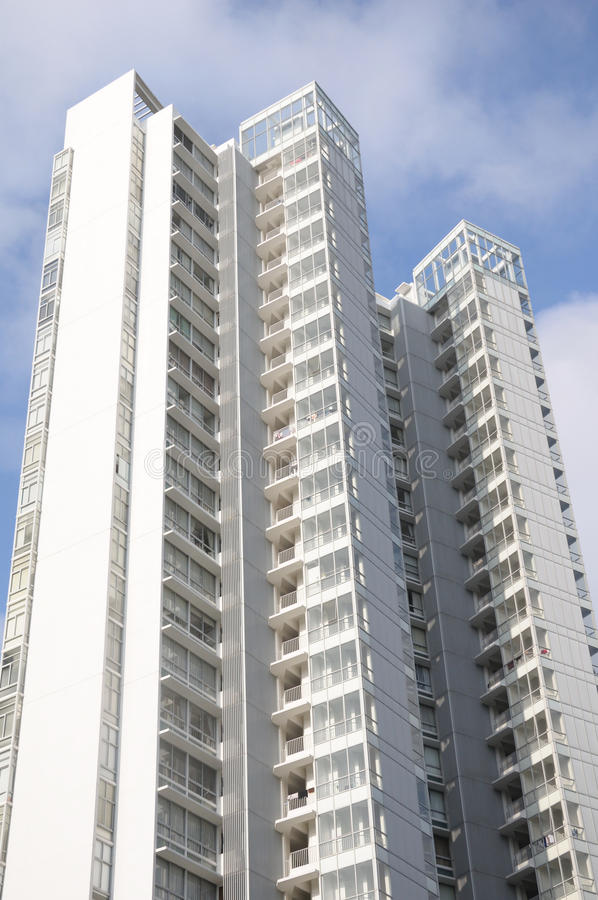 High Rise Apartment Building. A photo taken on a white painted high rise apartment building stock photography