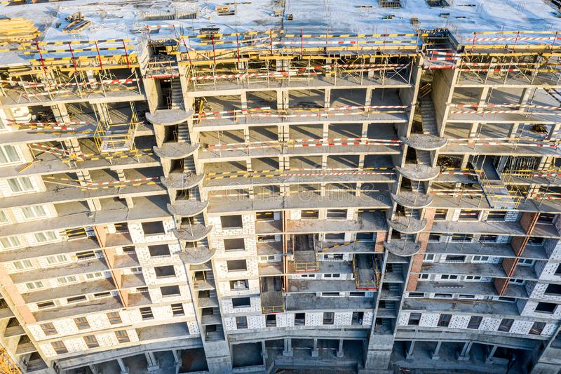 High-rise apartment building under construction. city construction site aerial view royalty free stock photo