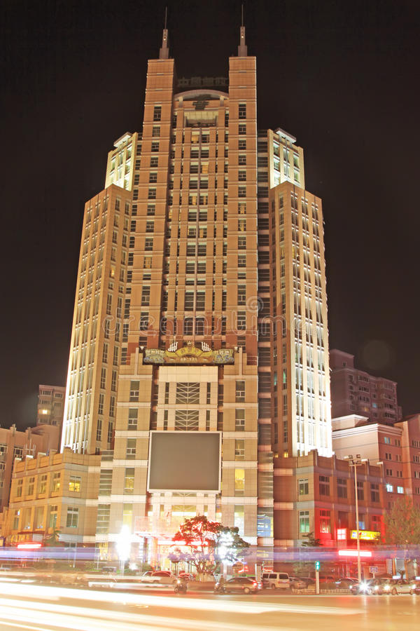 High rise building. In the city at night royalty free stock image