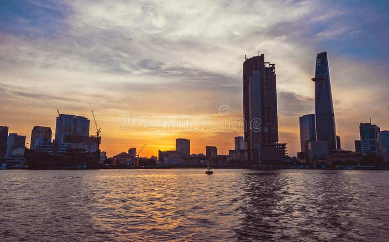 High-rise Building in Front of Body of Water during Sunset stock photo