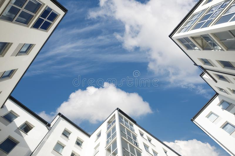 Skyscrapers in low perspective with a blue sky and clouds. High-rise building in low perspective stock photography