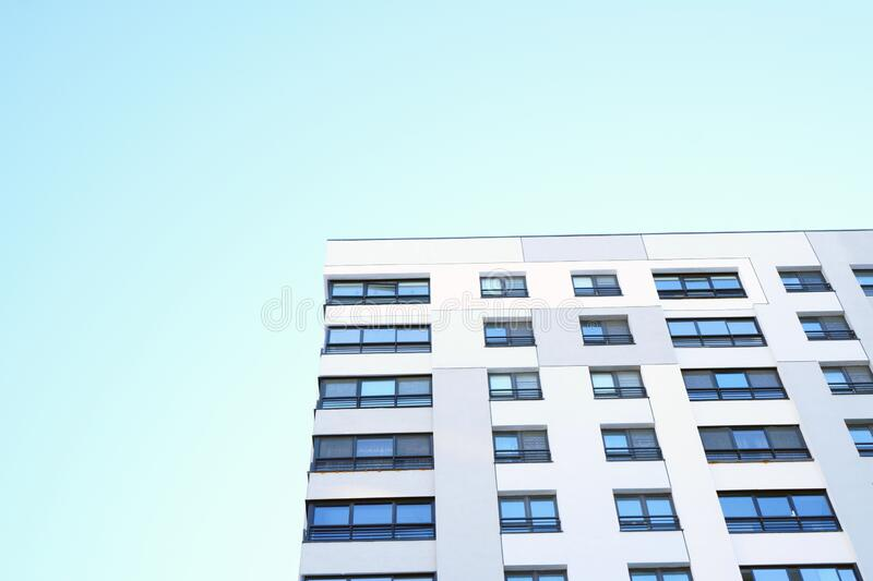 High-rise building in a modern style. Residential, office building in the city metropolis. Comfortable housing for the active royalty free stock images