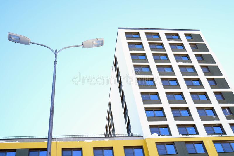 High-rise building in a modern style. Residential, office building in the city metropolis. Comfortable housing for the active stock images
