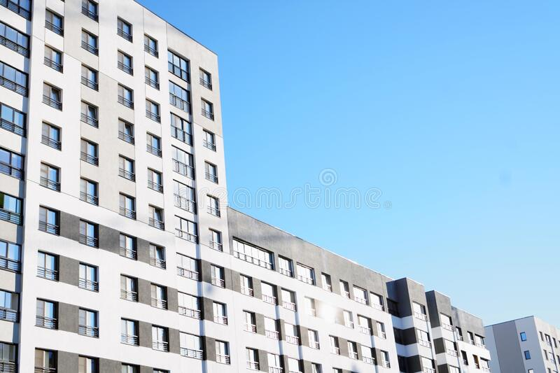 High-rise building in a modern style. Residential, office building in the city metropolis. Comfortable housing for the active stock photo