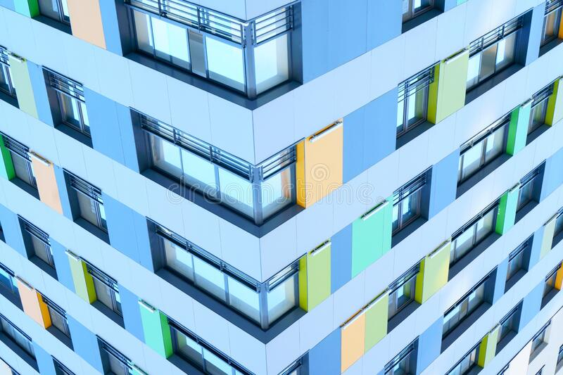High-rise building in a modern style. Residential, office building in the city metropolis. Comfortable housing for the active royalty free stock image