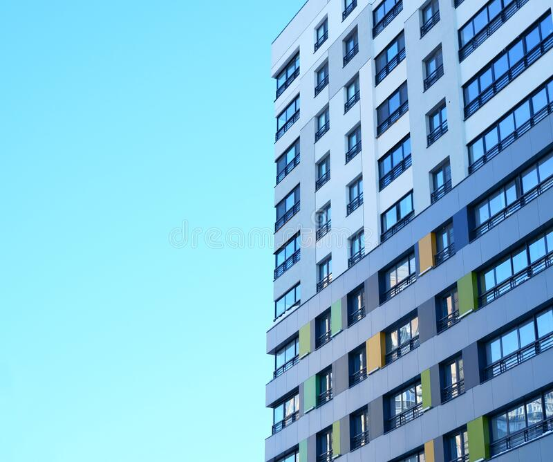 High-rise building in a modern style. Residential, office building in the city metropolis. Comfortable housing for the active royalty free stock photo