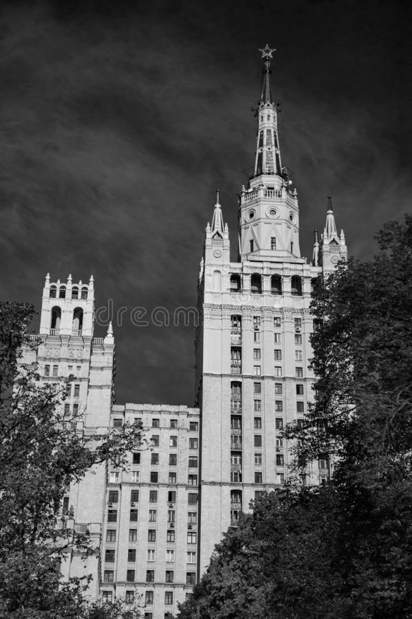 Black and White photo. The High-rise building one of Stalin skyscrapers inn Moscow. The High-rise building on the Barrikadnaya Metro subway station of Moscow on stock photos