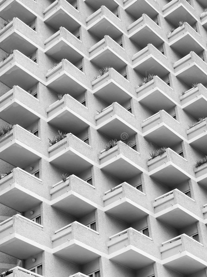 High rise building with residential flats or apartments. In a white concrete development with balconies royalty free stock photo