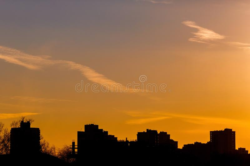High rise building silhouette in yellow background. Urban concept. City life stock photos