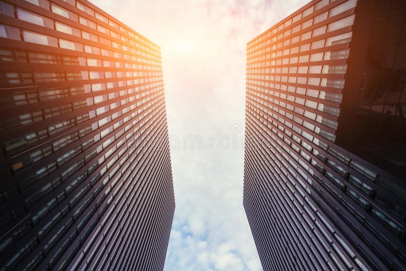 High-rise building in the sky. Through sun rays royalty free stock images