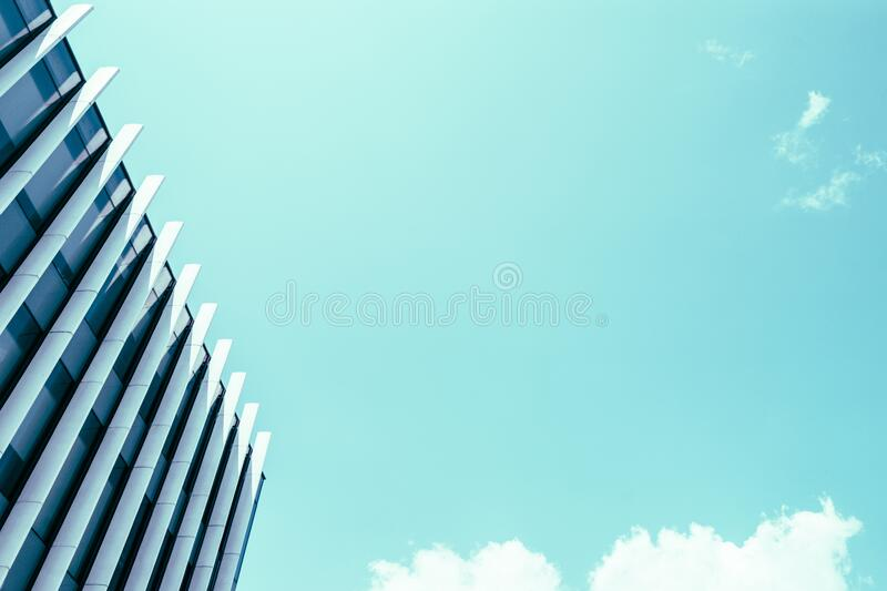 High Rise Building Under White Clouds and Blue Sky royalty free stock images