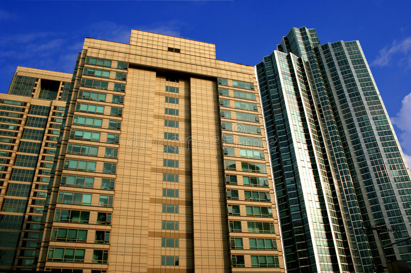 High Rise Buildings. A High rise building side by side in seoul Korea with nice blue sky as background stock images