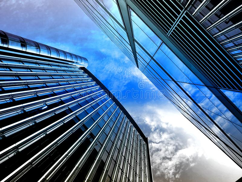 High rise buildings against blue skies royalty free stock images