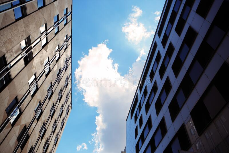 High rise buildings against blue skies stock photos