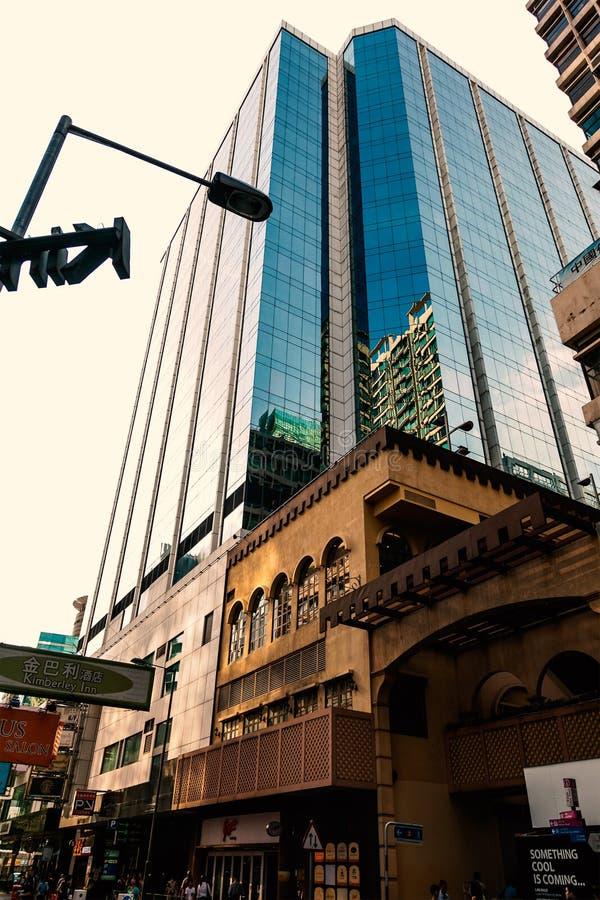 High rise buildings on the street of Hong Kong. High rise buildings on the street of Nathan Road, Hong Kong, China, 21 june, 2013 royalty free stock photos