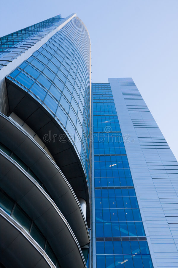 High-rise modern office building. Over blue sky royalty free stock photo