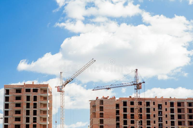 High-rise multi-storey buildings under construction. Tower cranes near building. Activity, architecture, development process,. Skyscraper royalty free stock photos