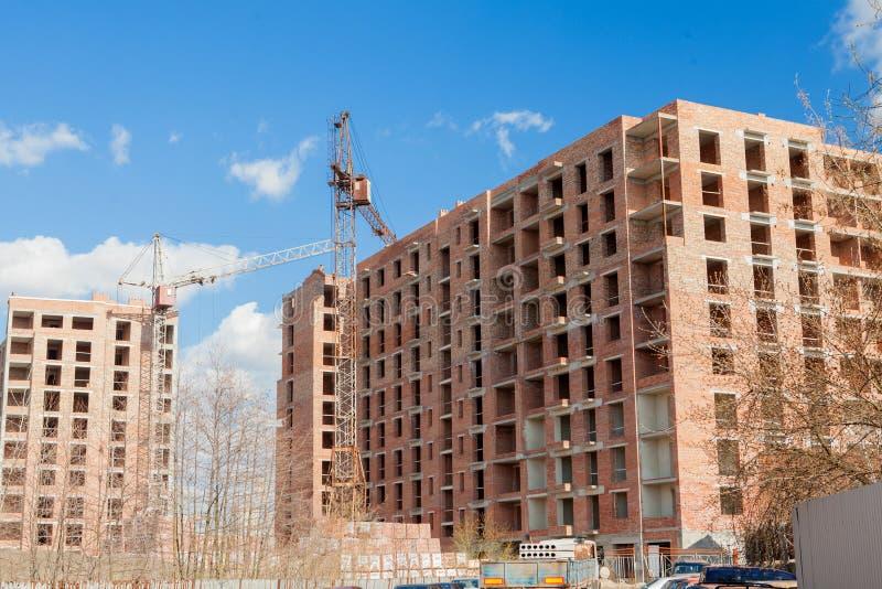 High-rise multi-storey buildings under construction. Tower cranes near building. Activity, architecture, development process, stock images