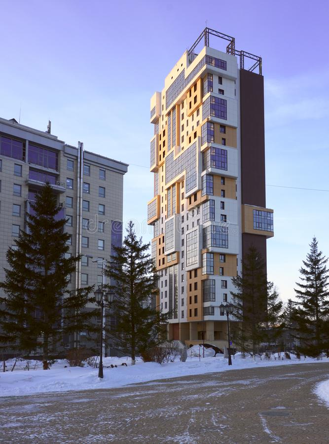 High-rise building of modern architecture in Novosibirsk. High-rise residential building with an original appearance, combining beige and yellow facade panels stock photos