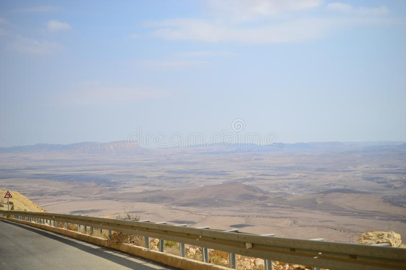 High road at bottom of Makhtesh Ramon Crater, Mitzpe Ramon, Negev desert, Israel stock images